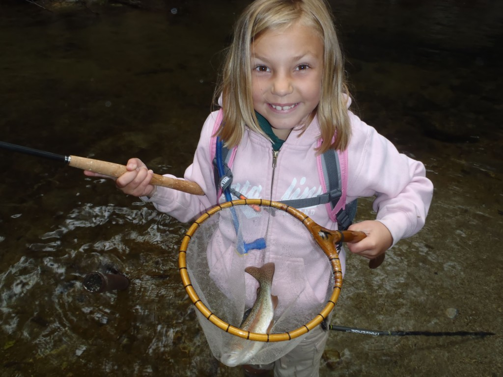 Girl caught a fish on tenkara