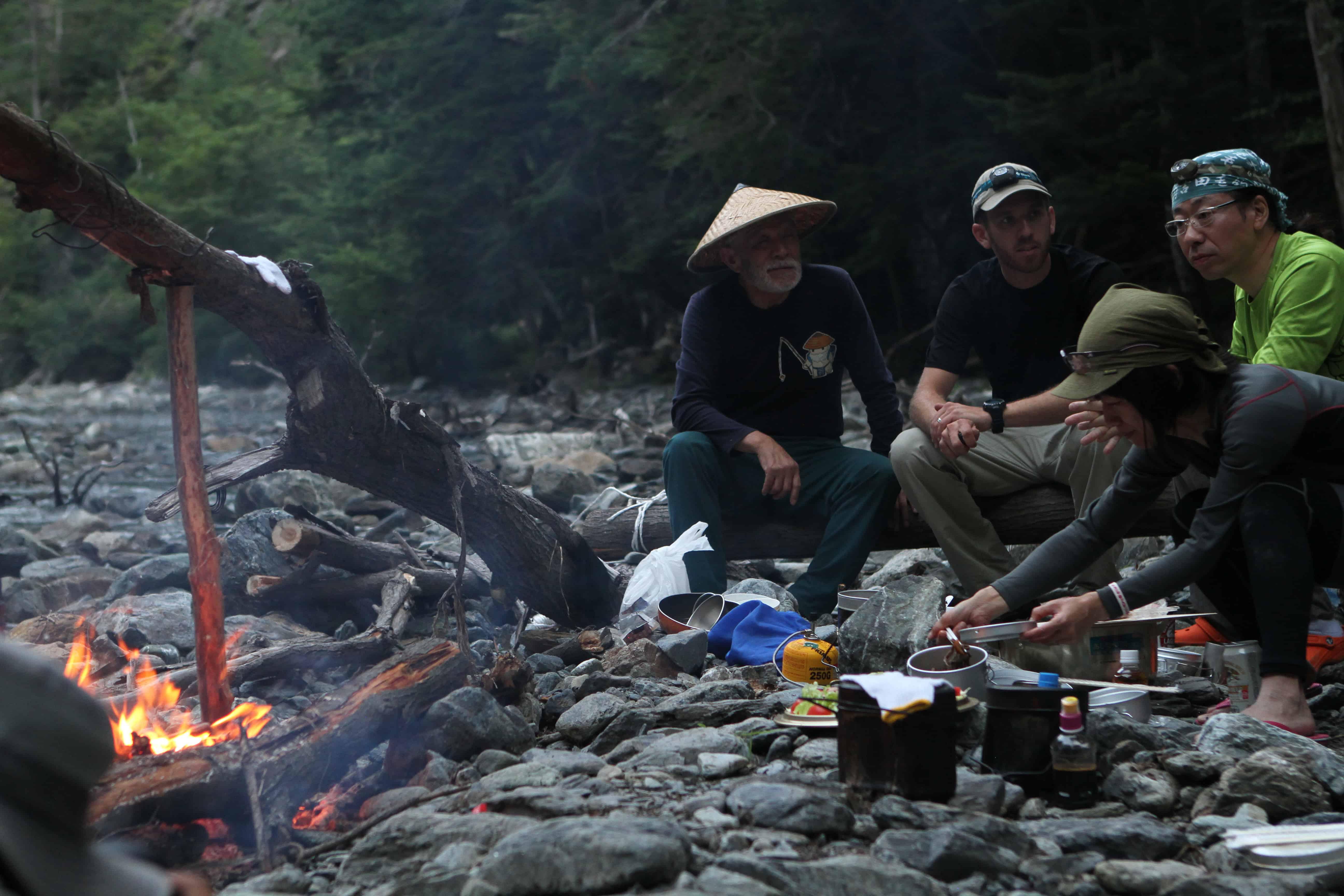 Tenkara anglers around a campfire