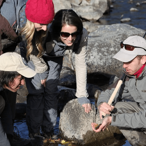 Daniel Galhardo shows a trout to tenkara girls in Boulder