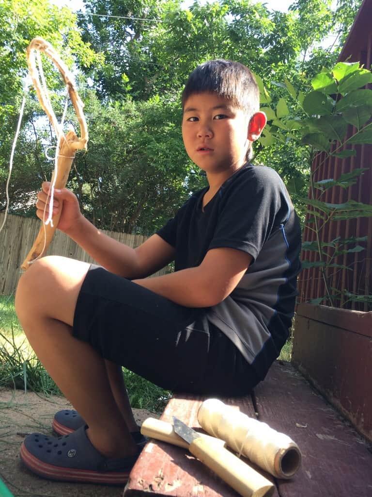 Kid showing his tenkara net